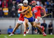 10 July 2019; Aidan McCarthy of Clare in action against Tommy O'Connell of Cork during the Bord Gais Energy Munster GAA Hurling Under 20 Championship semi-final match between Cork and Clare at Páirc Ui Rinn in Cork. Photo by Brendan Moran/Sportsfile