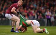 6 July 2019; Colm Boyle of Mayo with Sean Andy Ó Ceallaigh of Galway during the GAA Football All-Ireland Senior Championship Round 4 match between Galway and Mayo at the LIT Gaelic Grounds in Limerick. Photo by Brendan Moran/Sportsfile