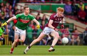 6 July 2019; Peter Cooke of Galway in action against Donal Vaughan of Mayo during the GAA Football All-Ireland Senior Championship Round 4 match between Galway and Mayo at the LIT Gaelic Grounds in Limerick. Photo by Brendan Moran/Sportsfile