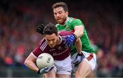 6 July 2019; Ian Burke of Galway in action against Chris Barrett of Mayo during the GAA Football All-Ireland Senior Championship Round 4 match between Galway and Mayo at the LIT Gaelic Grounds in Limerick. Photo by Brendan Moran/Sportsfile