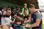 12 July 2019; Jonathan Sexton signs autographs for supporters after an Ireland Rugby open training session at the Sportsground in Galway. Photo by Matt Browne/Sportsfile