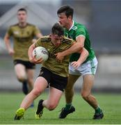 11 July 2019; Cathal Ferriter of Kerry in action against Karl Moloney of Limerick during the EirGrid GAA Football Under 20 Munster Championship Semi-Final match between Kerry and Limerick at Austin Stack Park in Tralee, Kerry. Photo by Brendan Moran/Sportsfile