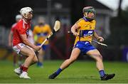 10 July 2019; Cathal Darcy of Clare in action against Tommy O'Connell of Cork during the Bord Gais Energy Munster GAA Hurling Under 20 Championship semi-final match between Cork and Clare at Páirc Ui Rinn in Cork. Photo by Brendan Moran/Sportsfile