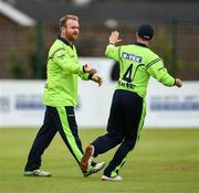 12 June 2019; Paul Stirling of Ireland is congratulated by Tyrone Kane after a catch during the 2nd T20 Cricket International match between Ireland and Zimbabwe at Bready Cricket Club in Magheramason, Co. Tyrone. Photo by Oliver McVeigh/Sportsfile