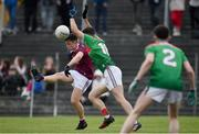 10 July 2019; Padraig Costello of Galway scores a point despite the efforts of David Gannon of Mayo during the EirGrid Connacht GAA Football U20 Championship final match between Galway and Mayo at Tuam, Co. Galway. Photo by Sam Barnes/Sportsfile