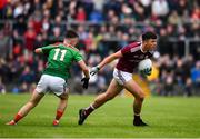 10 July 2019; Michael Culhane of Galway in action against Paul Towey of Mayo during the EirGrid Connacht GAA Football U20 Championship final match between Galway and Mayo at Tuam, Co. Galway. Photo by Sam Barnes/Sportsfile