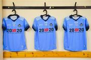"13 July 2019; A general view of the Dublin jerseys of, from left, Lyndsey Davey, Niamh Hetherton, and Noëlle Healy in the dressing room with the 20x20 campaign logo which has replaced that of sponsor AIG Ireland today to help promote awareness of the ""If She Can't See It, She Can't Be It"" initiative, designed to shift Ireland's cultural perception of women's sport by increasing media coverage, participation & attendance in women's sport by 20% by the year 2020. TG4 All-Ireland Ladies Football Senior Championship Group 2 Round 1 match between Dublin and Waterford at O'Moore Park in Portlaoise, Laois. Photo by Piaras Ó Mídheach/Sportsfile"