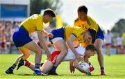 13 July 2019; Peter Harte of Tyrone is tackled by Ronan Daly, left, Conor Daly and Niall Daly of Roscommon during the GAA Football All-Ireland Senior Championship Quarter-Final Group 2 Phase 1 match between Roscommon and Tyrone at Dr Hyde Park in Roscommon. Photo by Brendan Moran/Sportsfile