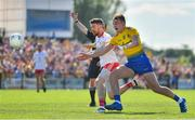 13 July 2019; Mattie Donnelly of Tyrone in action against Enda Smith of Roscommon during the GAA Football All-Ireland Senior Championship Quarter-Final Group 2 Phase 1 match between Roscommon and Tyrone at Dr Hyde Park in Roscommon. Photo by Brendan Moran/Sportsfile
