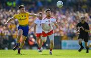 13 July 2019; Mattie Donnelly of Tyrone in action against Conor Daly of Roscommon during the GAA Football All-Ireland Senior Championship Quarter-Final Group 2 Phase 1 match between Roscommon and Tyrone at Dr Hyde Park in Roscommon. Photo by Brendan Moran/Sportsfile