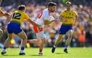 13 July 2019; Mattie Donnelly of Tyrone is tackled by Niall Kilroy of Roscommon during the GAA Football All-Ireland Senior Championship Quarter-Final Group 2 Phase 1 match between Roscommon and Tyrone at Dr Hyde Park in Roscommon. Photo by Brendan Moran/Sportsfile