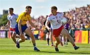 13 July 2019; Peter Harte of Tyrone in action against Conor Daly of Roscommon during the GAA Football All-Ireland Senior Championship Quarter-Final Group 2 Phase 1 match between Roscommon and Tyrone at Dr Hyde Park in Roscommon. Photo by Brendan Moran/Sportsfile