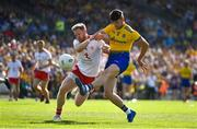 13 July 2019; Shane Killoran of Roscommon gets a shot in despite the efforts of Frank Burns of Tyrone during the GAA Football All-Ireland Senior Championship Quarter-Final Group 2 Phase 1 match between Roscommon and Tyrone at Dr Hyde Park in Roscommon. Photo by Brendan Moran/Sportsfile