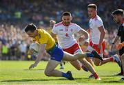 13 July 2019; Tadgh O'Rourke of Roscommon in action against Padraig Hampsey of Tyrone during the GAA Football All-Ireland Senior Championship Quarter-Final Group 2 Phase 1 match between Roscommon and Tyrone at Dr Hyde Park in Roscommon. Photo by Brendan Moran/Sportsfile