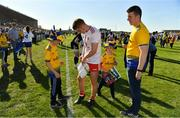 13 July 2019; Peter Harte of Tyrone signs an autograph for a Roscommon fan after the GAA Football All-Ireland Senior Championship Quarter-Final Group 2 Phase 1 match between Roscommon and Tyrone at Dr Hyde Park in Roscommon. Photo by Brendan Moran/Sportsfile