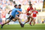 13 July 2019; Paul Kerrigan of Cork in action against Michael Darragh Macauley of Dublin during the GAA Football All-Ireland Senior Championship Quarter-Final Group 2 Phase 1 match between Dublin and Cork at Croke Park in Dublin. Photo by Eóin Noonan/Sportsfile