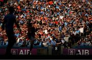 13 July 2019; Supporters watch on as Mark Collins of Cork scores a point for his side during the GAA Football All-Ireland Senior Championship Quarter-Final Group 2 Phase 1 match between Dublin and Cork at Croke Park in Dublin. Photo by Eóin Noonan/Sportsfile