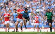 13 July 2019; Cian O'Sullivan of Dublin in action against Seán White of Cork during the GAA Football All-Ireland Senior Championship Quarter-Final Group 2 Phase 1 match between Dublin and Cork at Croke Park in Dublin. Photo by Eóin Noonan/Sportsfile
