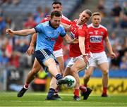 13 July 2019; Jack McCaffrey of Dublin shoots past Seán White of Cork to score the game's opening goal in the eleventh minute during the GAA Football All-Ireland Senior Championship Quarter-Final Group 2 Phase 1 match between Dublin and Cork at Croke Park in Dublin. Photo by Ray McManus/Sportsfile