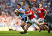 13 July 2019; Brian Howard of Dublin in action against Liam O'Donovan of Cork during the GAA Football All-Ireland Senior Championship Quarter-Final Group 2 Phase 1 match between Dublin and Cork at Croke Park in Dublin. Photo by Daire Brennan/Sportsfile