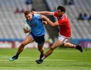 13 July 2019; Ciarán Kilkenny of Dublin in action against Tomás Clancy of Cork during the GAA Football All-Ireland Senior Championship Quarter-Final Group 2 Phase 1 match between Dublin and Cork at Croke Park in Dublin. Photo by Ray McManus/Sportsfile