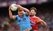 13 July 2019; Ciarán Kilkenny of Dublin catches the ball under pressure from Tomás Clancy of Cork during the GAA Football All-Ireland Senior Championship Quarter-Final Group 2 Phase 1 match between Dublin and Cork at Croke Park in Dublin. Photo by Ray McManus/Sportsfile