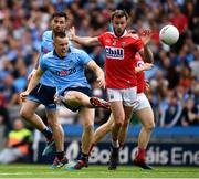 13 July 2019; Con O'Callaghan of Dublin scores a point, in the eighth minute, despite pressure from James Loughrey of Cork during the GAA Football All-Ireland Senior Championship Quarter-Final Group 2 Phase 1 match between Dublin and Cork at Croke Park in Dublin. Photo by Ray McManus/Sportsfile
