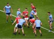13 July 2019; Ian Maguire of Cork comes away with the ball ahead of John Small, left, and Ciarán Kilkenny of Dublin during the GAA Football All-Ireland Senior Championship Quarter-Final Group 2 Phase 1 match between Dublin and Cork at Croke Park in Dublin. Photo by Daire Brennan/Sportsfile