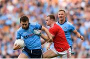 13 July 2019; Jack McCaffrey of Dublin is tackled by Mattie Taylor of Cork during the GAA Football All-Ireland Senior Championship Quarter-Final Group 2 Phase 1 match between Dublin and Cork at Croke Park in Dublin. Photo by Eóin Noonan/Sportsfile