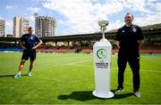 14 July 2019; Republic of Ireland head coach Tom Mohan poses for media with the trophy while Norway head coach Gunnar Halle waits to the side following a press conference at the Republican Stadium ahead of his side's opening game of the 2019 UEFA European U19 Championship Finals in Yerevan, Armenia. Photo by Stephen McCarthy/Sportsfile