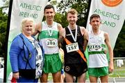 13 July 2019; Athletics Ireland President Georgina Drumm, with David Flynn from Clonliffe Harriers AC, after he won the Irish Runner 10 Mile, with second place David Mansfield, right, from Clonmel AC, Co Tipperary, and third place Cillian O'Leary, left, from Raheny Shamrocks AC, Dublin, following the Irish Runner 10 Mile in conjunction with the AAI National 10 Mile Championships at Phoenix Park in Dublin. Photo by Matt Browne/Sportsfile