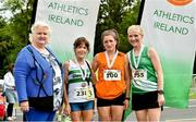 13 July 2019; Athletics Ireland President Georgina Drumm, with Niamh Clifford from Star of the Laune AC, Co Kerry, after winning the ladies Irish Runner 10 Mile, with second place Sally Forristal, right, from St Joseph's AC, Co Kilkenny, and third place Angela McCann, left, from Clonmel AC, Co Tipperary, following the Irish Runner 10 Mile in conjunction with the AAI National 10 Mile Championships at Phoenix Park in Dublin. Photo by Matt Browne/Sportsfile