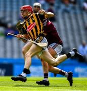 14 July 2019; Colman O'Sullivan of Kilkenny in action against Ian McGlynn of Galway during the Electric Ireland GAA Hurling All-Ireland Minor Championship quarter-final match between Kilkenny and Galway at Croke Park in Dublin. Photo by Ray McManus/Sportsfile