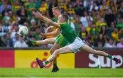 14 July 2019; Oisín Gallen of Donegal in action against Conor McGill of Meath during the GAA Football All-Ireland Senior Championship Quarter-Final Group 1 Phase 1 match between Donegal and Meath at MacCumhaill Park in Ballybofey, Donegal. Photo by Daire Brennan/Sportsfile