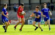 14 July 2019; Michael McGleenan of Tyrone in action against Monaghan players, from left, Kyle Connolly, Ronan Boyle, and Conor McKernan during the Electric Ireland Ulster GAA Football Minor Championship Final match between Monaghan and Tyrone at Athletic Grounds in Armagh. Photo by Piaras Ó Mídheach/Sportsfile