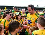 14 July 2019; Michael Murphy of Donegal signs autographs after the GAA Football All-Ireland Senior Championship Quarter-Final Group 1 Phase 1 match between Donegal and Meath at MacCumhaill Park in Ballybofey, Donegal. Photo by Daire Brennan/Sportsfile