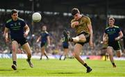 14 July 2019; Sean O'Shea of Kerry kicks a point despite the efforts of Lee Keegan of Mayo during the GAA Football All-Ireland Senior Championship Quarter-Final Group 1 Phase 1 match between Kerry and Mayo at Fitzgerald Stadium in Killarney, Kerry. Photo by Brendan Moran/Sportsfile