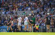 14 July 2019; Referee Colm Lyons issues a yellow card to both Willie Dunphy of Laois, 13, and Padraic Maher of Tipperary, 6, during the GAA Hurling All-Ireland Senior Championship quarter-final match between Tipperary and Laois at Croke Park in Dublin. Photo by Ray McManus/Sportsfile