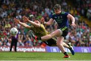 14 July 2019; Cillian O'Connor of Mayo has a shot on goal despite te best efforts of Tadhg Morley of Kerry during the GAA Football All-Ireland Senior Championship Quarter-Final Group 1 Phase 1 match between Kerry and Mayo at Fitzgerald Stadium in Killarney, Kerry. Photo by Brendan Moran/Sportsfile