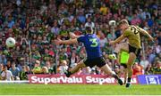 14 July 2019; James O'Donoghue of Kerry has a shot on goal despite the best efforts of Brendan Harrison of Mayo during the GAA Football All-Ireland Senior Championship Quarter-Final Group 1 Phase 1 match between Kerry and Mayo at Fitzgerald Stadium in Killarney, Kerry. Photo by Brendan Moran/Sportsfile