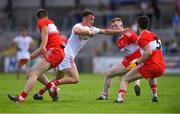 14 July 2019; Darragh Canavan of Tyrone in action against Derry players, from left, Dara Rafferty, Declan Cassidy and Conor McCluskey during the EirGrid Ulster GAA Football U20 Championship Final match between Derry and Tyrone at Athletic Grounds in Armagh. Photo by Piaras Ó Mídheach/Sportsfile
