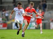 14 July 2019; Darragh Canavan of Tyrone in action against Fintan Bradley of Derry during the EirGrid Ulster GAA Football U20 Championship Final match between Derry and Tyrone at Athletic Grounds in Armagh. Photo by Piaras Ó Mídheach/Sportsfile