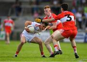 14 July 2019; Darragh Canavan of Tyrone in action against Declan Cassidy, centre, and Conor McCluskey of Derry during the EirGrid Ulster GAA Football U20 Championship Final match between Derry and Tyrone at Athletic Grounds in Armagh. Photo by Piaras Ó Mídheach/Sportsfile