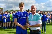 14 July 2019; Karl Gallagher of Monaghan receiving his Electric Ireland Man of the Match award from Vincent Litchfield, Customer Relationship Manger at Electric Ireland, following the Electric Ireland Ulster GAA Football Minor Championship Final match between Monaghan and Tyrone at Athletic Grounds in Armagh. Photo by Piaras Ó Mídheach/Sportsfile