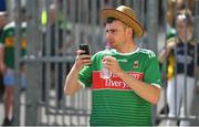 14 July 2019; A Mayo supporter videos the Kerry team arrival prior to the GAA Football All-Ireland Senior Championship Quarter-Final Group 1 Phase 1 match between Kerry and Mayo at Fitzgerald Stadium in Killarney, Kerry. Photo by Brendan Moran/Sportsfile