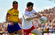 13 July 2019; Rory Brennan of Tyrone in action against Conor Cox of Roscommon during the GAA Football All-Ireland Senior Championship Quarter-Final Group 2 Phase 1 match between Roscommon and Tyrone at Dr Hyde Park in Roscommon. Photo by Brendan Moran/Sportsfile