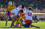 13 July 2019; Tadgh O'Rourke of Roscommon under pressure from Tyrone players Michael McKernan, Padraig Hampsey and Kieran McGeary during the GAA Football All-Ireland Senior Championship Quarter-Final Group 2 Phase 1 match between Roscommon and Tyrone at Dr Hyde Park in Roscommon. Photo by Brendan Moran/Sportsfile