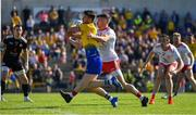 13 July 2019; Shane Killoran of Roscommon attempts to keep the ball in play despite the efforts of Richie Donnelly of Tyrone during the GAA Football All-Ireland Senior Championship Quarter-Final Group 2 Phase 1 match between Roscommon and Tyrone at Dr Hyde Park in Roscommon. Photo by Brendan Moran/Sportsfile