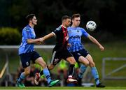 15 July 2019; Keith Ward of Bohemians in action against Evan Farrell, left, and Harry McEvoy of UCD during the SSE Airtricity League Premier Division match between UCD and Bohemians at UCD Bowl in Dublin. Photo by Seb Daly/Sportsfile