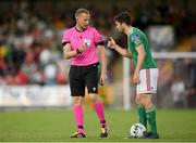 11 July 2019; Referee Aleksandrs Anufrijevs with Gearóid Morrissey of Cork City during the UEFA Europa League First Qualifying Round 1st Leg match between Cork City and Progres Niederkorn at Turners Cross in Cork. Photo by Eóin Noonan/Sportsfile